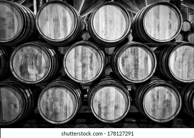 Old barrels for Whisky or wine on white and black