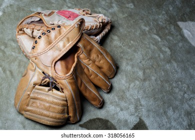 Old baseball glove with mat