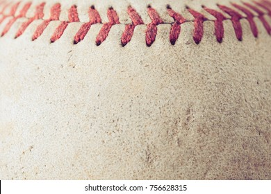 old Baseball on wood background with filter effect retro vintage style