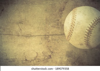 Old baseball on wooden background and copy space.