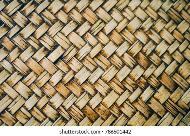 Old Basket of Bamboo Wicker Work Thai Style Handicraft from Natural Rattan Palms Macro Closeup as Weaving Wicker Pattern Texture Grunge Dirty Background Backdrop Oriental Exotic Asian Cuture Concept