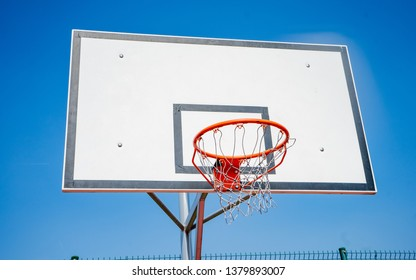 Old basket Stadium.The game could begin. Basketball hoop above outdoor playground with sky in the background