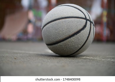 Old basketball in the empty court