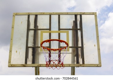 old basketball hoop with clound and sky