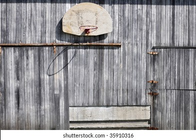 old basketball hoop on barn