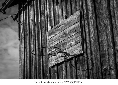 Old basketball hoop on the side of a weathered barn in Neosho, Wisconsin