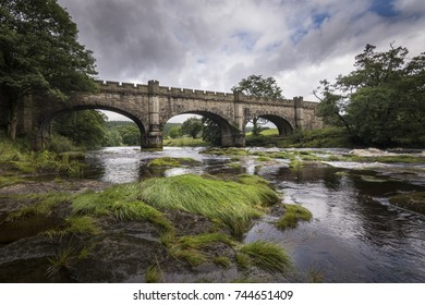Old beautiful bridge over river Wharfe Bolton Abbey England