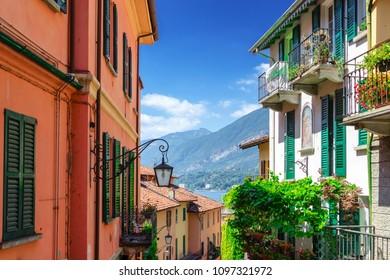 Old beautiful street with colorful architecture in Bellagio, Como lake, Italy. Bellagio cityscape and landmark. Italian postcard