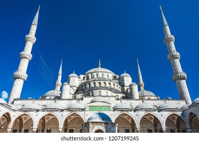 Old and beautiful Sultan Ahmed Mosque (Blue Mosque) Ottoman imperial mosque located in Istanbul, Turkey. Blue sky in background.