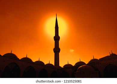 Old and beautiful Sultan Ahmed Mosque (Blue Mosque) Ottoman imperial mosque located in Istanbul, Turkey. Sunset sky in background.