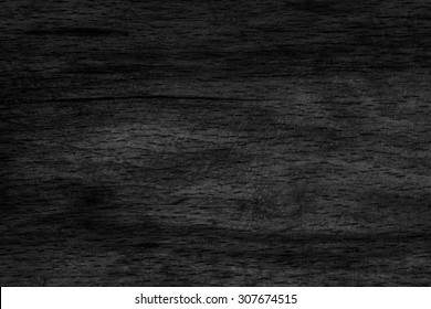 Old Beech Wood Bleached and Stained Charcoal Black Grunge Texture Sample.