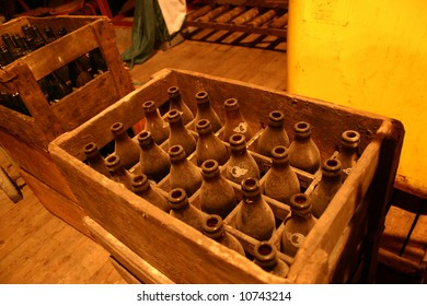 Old Beer Bottles in Crate
