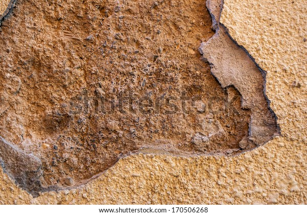 Old beige double cracked wall with a bummer