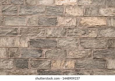 Old beige stone brick pattern background texture