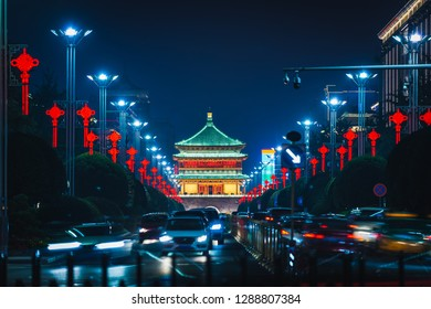 The old Bell Tower of Xian, China lit up at night.