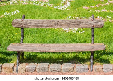 Old bench in the park. May 24 is European Parks Day