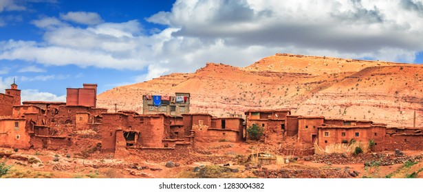Old berber architecture in High Atlas Mountains region in Morocco. Houses of clay at the foot of the mountains.
