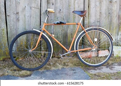 old Bicycle against the grey boards