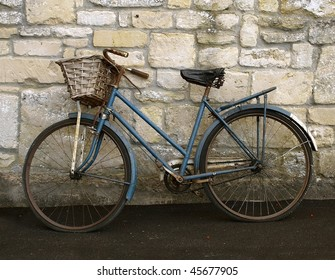 Old Bicycle against a Stone Wall