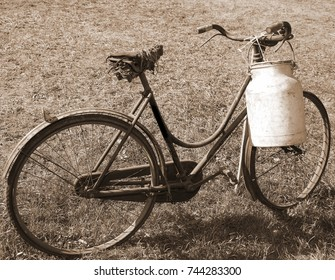 old bicycle with a broken saddle and the milk can milkman with sepia tone effect
