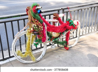 Old bicycle decorated for Christmas time.