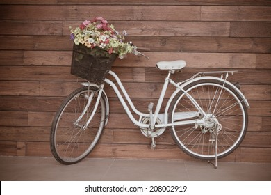 Old bicycle and flowers, vintage filter