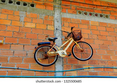 Old bicycle hang on brick wall