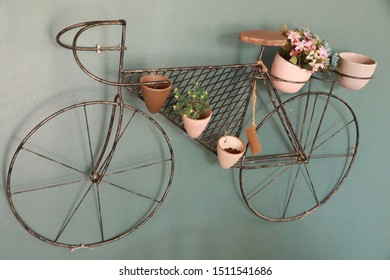 Old bicycle hanging on the wall with flower