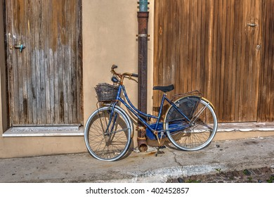old bicycle leaning against a wall in Sardinia, Italy