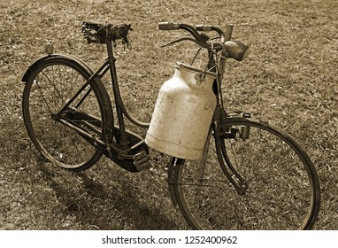 old bicycle milkman and the bin of aluminum for transporting the milked milk