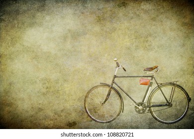 The old bicycle on the old brown paper