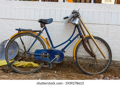 An old bicycle on the street in the frame