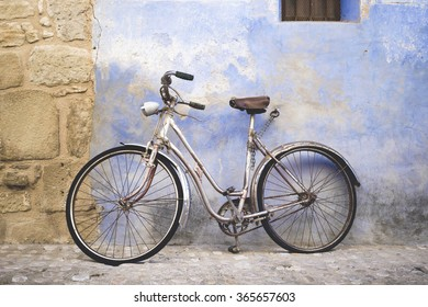 old bicycle on old wall
