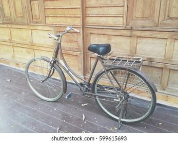 Old bicycle on wood floor