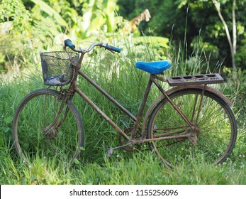 old bicycle was parked alone