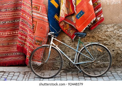 Old bicycle and traditional carpets on the street of Marrakesh, Morocco