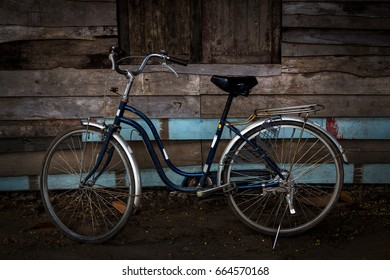 Old bicycle with vintage wooden wall