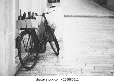 old bicycle with wooden box full of wine bottles