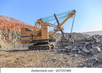 Old big mining excavator in an iron ore quarry