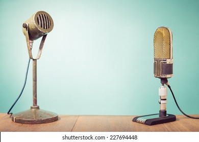 Old big retro studio microphones front mint green wall background
