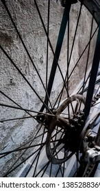Old bike close up in front of a neutral color rough wall