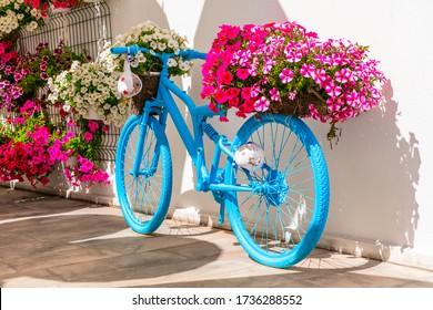 Old bike with flowers - street or garden decoaration ideas