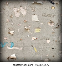 Old Billboard With Torn Poster Paper Ads And Stickers. Frame Background Or Square Texture. Vintage Urban Grunge Wallpaper For Design And Artwork With Copy Space For Text Or Image.