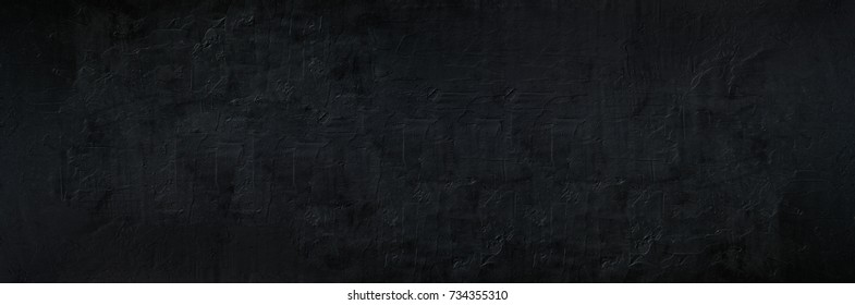 Old black abstract concrete background. Grunge texture. Dark wallpaper. Blackboard. Chalkboard. Top view, copy space. Banner
