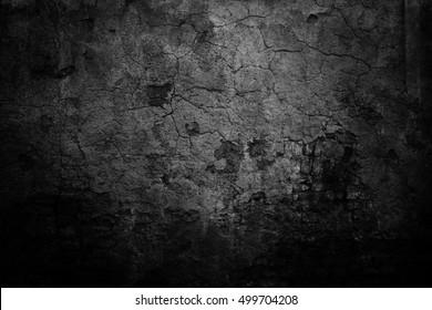 Old black background. Grunge texture. Distressed wallpaper