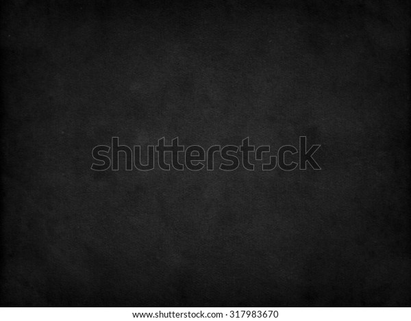 Old black background. Grunge texture. Dark wallpaper. Blackboard. Chalkboard. Concrete
