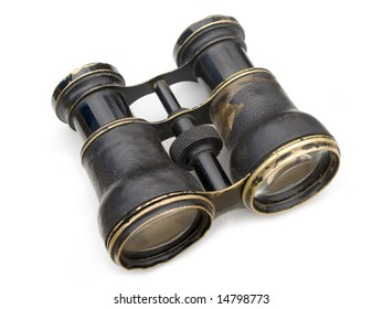 Old black binoculars isolated on white background.