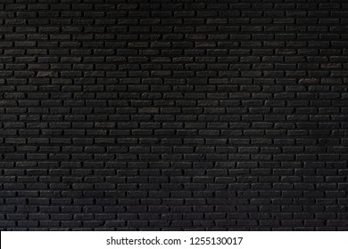 Old black brick wall texture ,brick wall texture for interior design vintage dark tone.