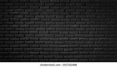 Old black brick wall texture ,brick wall texture for interior design vintage dark tone.