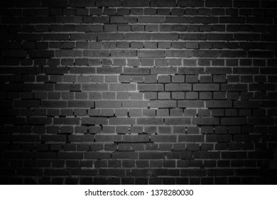 old black bricks wall surface abstract pattern background. Background of old vintage brick wall